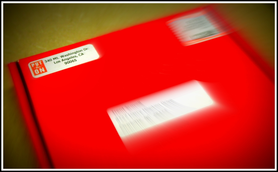 The packaging. The red box stands out nicely among your other ordinary  mail for the day, signaling something special.